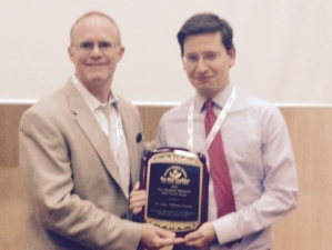 Dr. Palma being presented with his award from Don Crouse, Vice President of the MSA Coalition